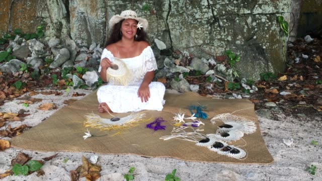 pacific islander woman wearing a rito hat, weaving a hand fan in rarotonga, cook islands - pacific islander stock videos & royalty-free footage