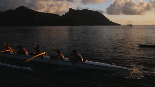 pacific islanders in an ocean canoe - french polynesia stock videos & royalty-free footage