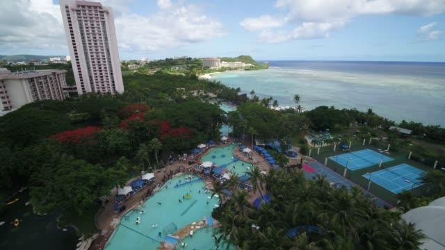 vídeos de stock, filmes e b-roll de pacific islands club in tumon bay, guam, united states - acampamento de férias