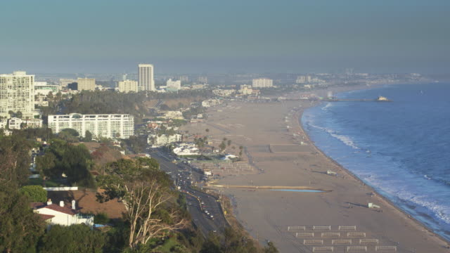 pacific palisades and santa monica - aerial shot - santa monica pier stock videos & royalty-free footage