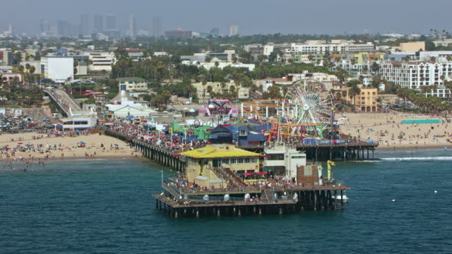 aerial pacific park on the santa monica pier in santa monica, ca - santa monica pier stock videos & royalty-free footage