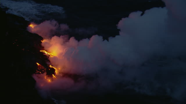 pacific waves with steaming lava flow in hawaii volcanoes national park at night. - big island hawaii islands stock videos & royalty-free footage