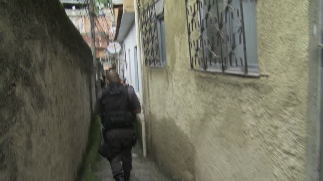 pacification police patrol in favela during a tense time amid breakdown of pacification in rio de janeiro. - south america stock videos & royalty-free footage