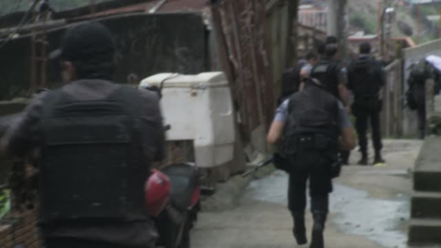 pacification police patrol in favela during a tense time amid breakdown of pacification in rio de janeiro. - drug trafficking stock videos & royalty-free footage