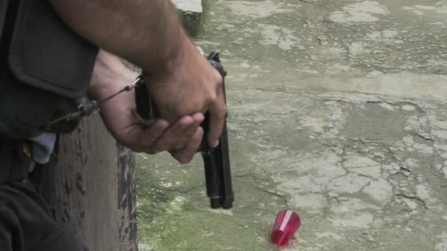 vídeos de stock e filmes b-roll de pacification police patrol in favela during a tense time amid breakdown of pacification in rio de janeiro - favela