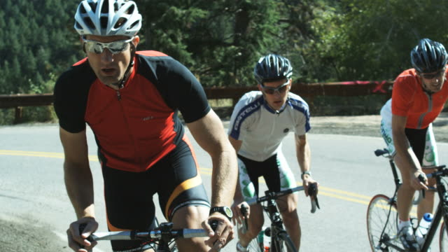 pack of cyclists climbing uphill - riding stock videos & royalty-free footage