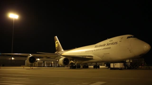 package containers are unloaded from cargo jets during the night package sort at the united parcel service inc worldport facility in louisville... - airplane tail stock videos and b-roll footage