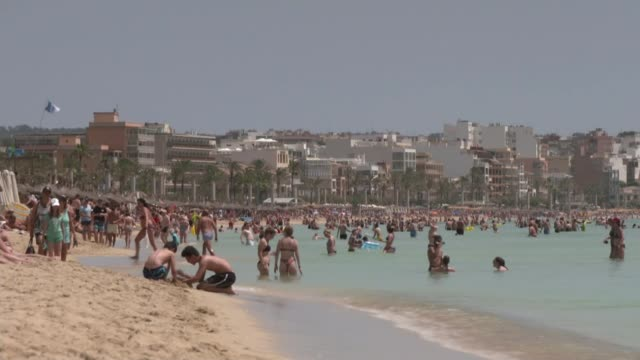 mallorca ext holidaymakers on crowded beach - majorca stock videos & royalty-free footage