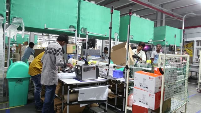 A package moves along a conveyor belt at the Amazoncom Inc fulfillment center in Hyderabad India on Thursday Sept 7 An employee prepares a package...