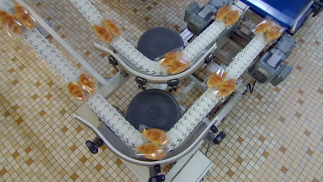 packaged croissants on factory production line - efficiency stock videos & royalty-free footage