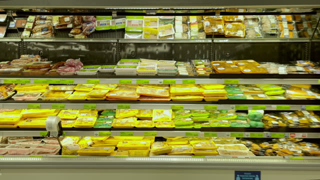 packaged food items very popular for consumer convenience in grocery stores on march 02 in los angeles, california. - raw food stock videos & royalty-free footage