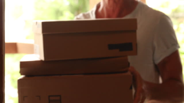 packages are delivered to front door of home - discovery stock videos & royalty-free footage