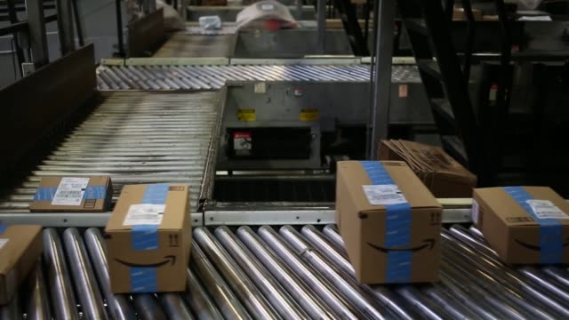 Packages are sorted at the United Parcel Service Inc Chicago Area Consolidation Hub in Hodgkins Illinois US on Cyber Monday Nov 28 2016 Shots view...