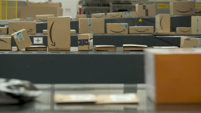packages flow along a conveyor belt at an amazon packaging center on november 28, 2019 in brieselang, germany. amazon is anticipating a strong... - pacco video stock e b–roll