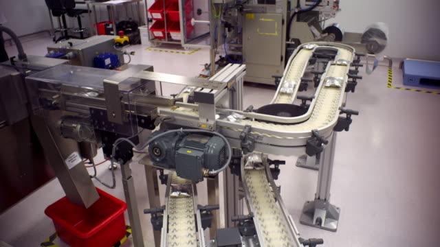 packages moving along a conveyer belt - pharmaceutical factory stock videos & royalty-free footage
