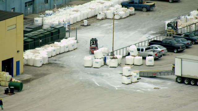 ms aerial packages of sugar being unloaded from truck at pioneer sugar factory / bay city, michigan, united states - sugar stock videos and b-roll footage