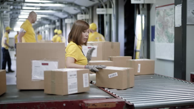 ds packages on the conveyor belt being sorted by the employees - belt stock videos and b-roll footage