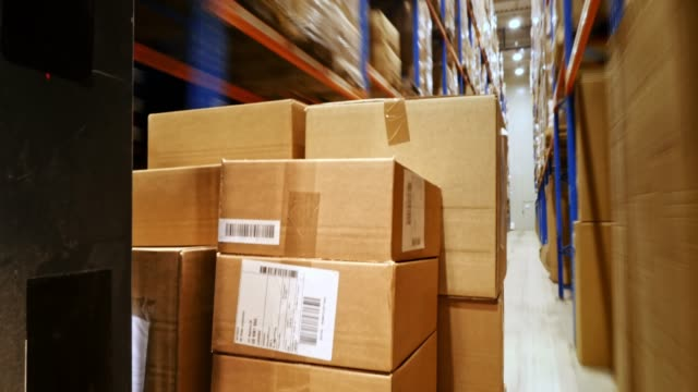 time lapse packages traveling through a warehouse - shipping stock videos & royalty-free footage