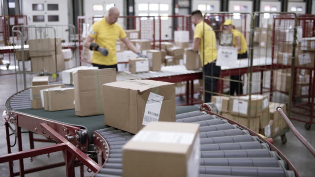 LD Packages travelling on the conveyor belt in the warehouse