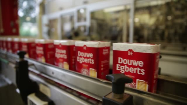 packaging for coffee moves along the production line at the douwe egberts production plant operated by de master blenders 1753 nv in utrecht... - utrecht stock videos and b-roll footage