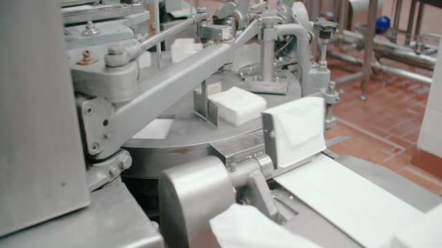 packaging line at food processing plant. packing machine at dairy factory. dairy products at conveyor belt. automated production line - food processing plant stock videos and b-roll footage