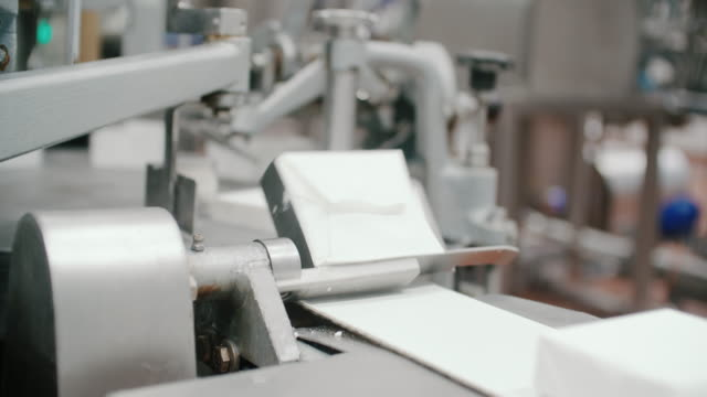 packaging line at food processing plant. packing machine at dairy factory. dairy products at conveyor belt. automated production line - ready meal stock videos & royalty-free footage
