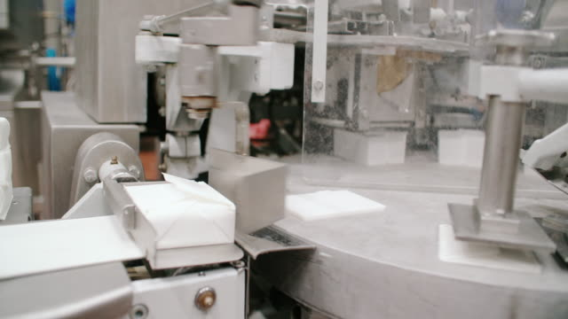 packaging line at food processing plant. packing machine at dairy factory. dairy products at conveyor belt. automated production line - convenience food stock videos and b-roll footage