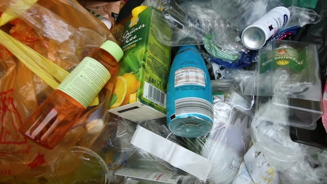 packaging materials much of it made of plastic lie in a recycling bin on august 20 2018 in berlin germany according to data for 2016 recently... - packaging stock videos and b-roll footage