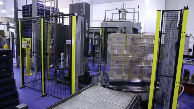 Packed bottles of milk move along a conveyor out of a packing machine at the a2 Milk Co plant in Sydney Australia on Friday Feb 26 Packed bottles of...