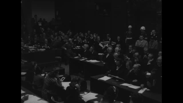 pan right packed courtroom at nuremberg military tribunal for nazi war crimes / mws high ranking nazi officials seated in courtroom / ms front row... - hermann goering stock videos and b-roll footage