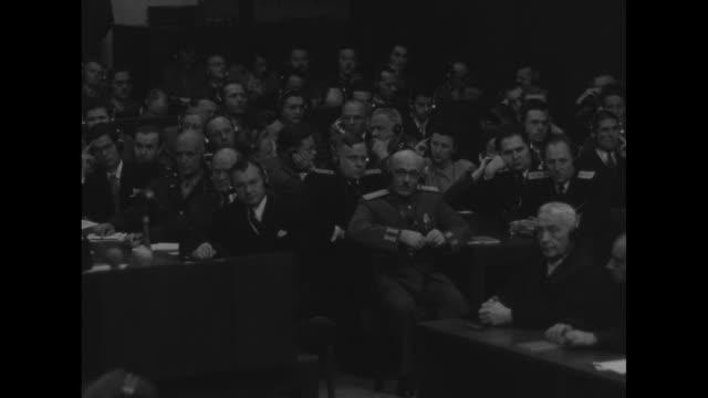 wspan packed courtroom during nuremberg trials / vs prosecuting attorneys listening thru headphones taking notes - nuremberg trials stock videos & royalty-free footage