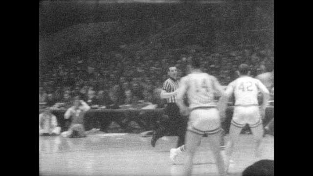 packed crowd attend the final game of the ncaa basketball championship played between dayton fliers and ucla bruins / game in progress / lew alcindor... - ucla stock videos & royalty-free footage