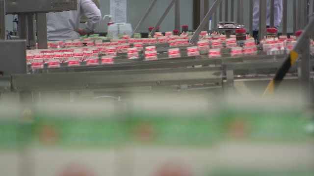packed milks moving on conveyor belt. - packaging stock videos & royalty-free footage