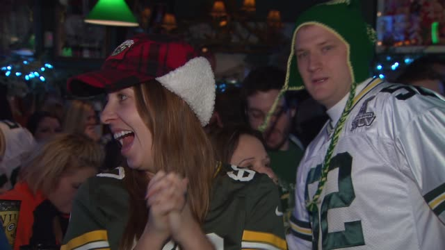 WGN Packers Fans Watching Game In Bar on December 29 2013 in Chicago Illinois