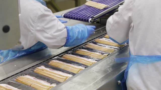Packets of bacon produced from imported Smithfield Foods Inc pork bellies move along a conveyor on a production line at the WH Group Ltd facility in...