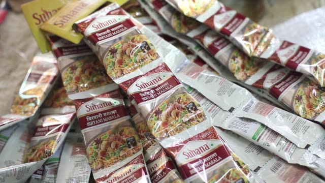Packets of Biryani Masala spice blend are seen in the packaging unit at a Suhana spice factory in Pune Maharashtra India on Monday Nov 28 A machine...