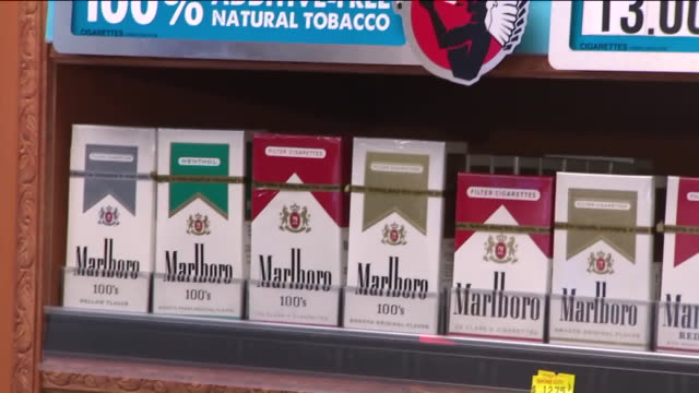 wpix packets of cigarettes inside liquor store - tobacco product stock videos and b-roll footage