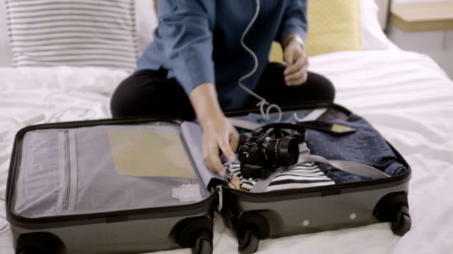 packing bags for holidays - luggage stock videos & royalty-free footage