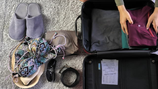 packing luggage - bagaglio video stock e b–roll