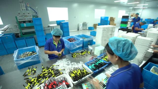 packing toothbrushes at shuguang toothbrush factory operations at the shuguang toothbrush factory in yangzhou jiangsu china on monday september 21... - large group of objects stock videos & royalty-free footage