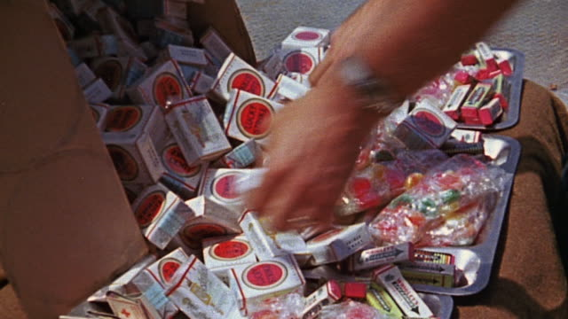 packs of cigarettes, gum, and candy spread out on trays and being grabbed a few at a time - cigarette stock videos & royalty-free footage