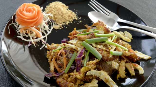 pad thai, fried noodles is a traditional thai food - ko samui stock videos and b-roll footage
