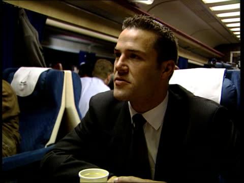vídeos y material grabado en eventos de stock de paddington station reopens after crash england gloucestershire cheltenham people seen inside ticket hall of station indicator screen on platform... - ceremonia de reapertura
