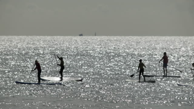 Paddle boarding in the open sea.