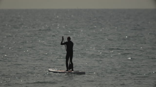 paddle boarding in the open sea. - bournemouth england stock videos & royalty-free footage