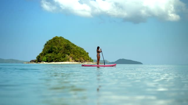paddle boarding on a tropical beach vacation in palawan, philippines - philippines stock videos & royalty-free footage