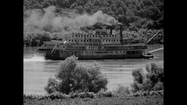 / paddle steam boat going down river steamboat on the river on january 01 1942 - paddle boat stock videos & royalty-free footage