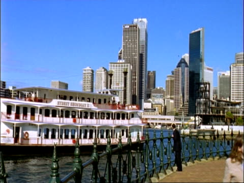 MS paddle steamer passing in front of highrise skyline, blue sky, Sydney, Australia