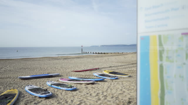 paddleboarding on boscombe beach, bournemouth, uk - bournemouth england stock videos & royalty-free footage