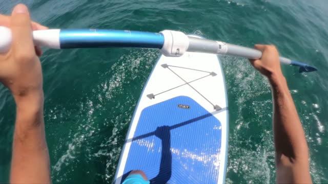 stockvideo's en b-roll-footage met paddleboarden - peddel